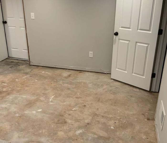 Room with subfloor exposed and trim missing
