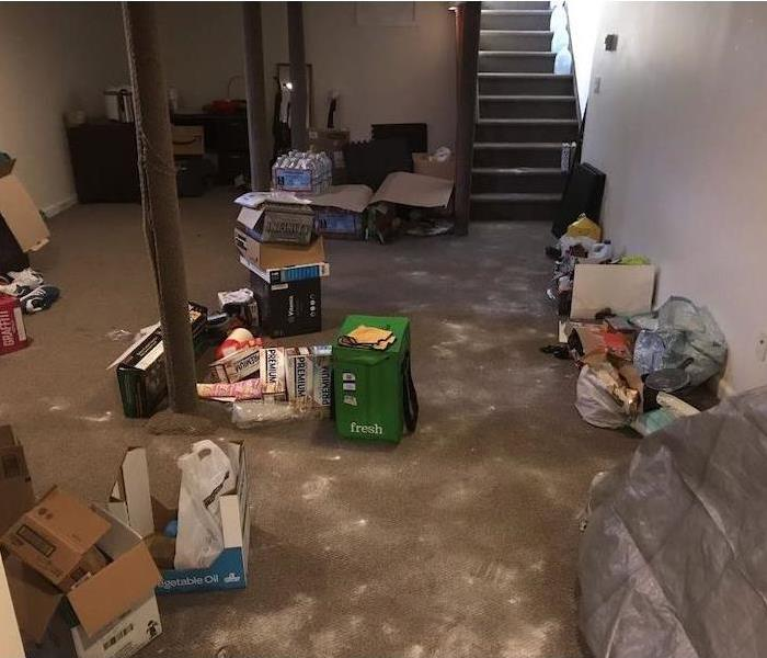 Basement with a wet floor and various items
