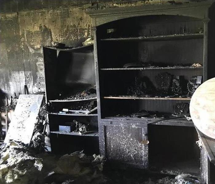 Fire damage to furniture in a room.