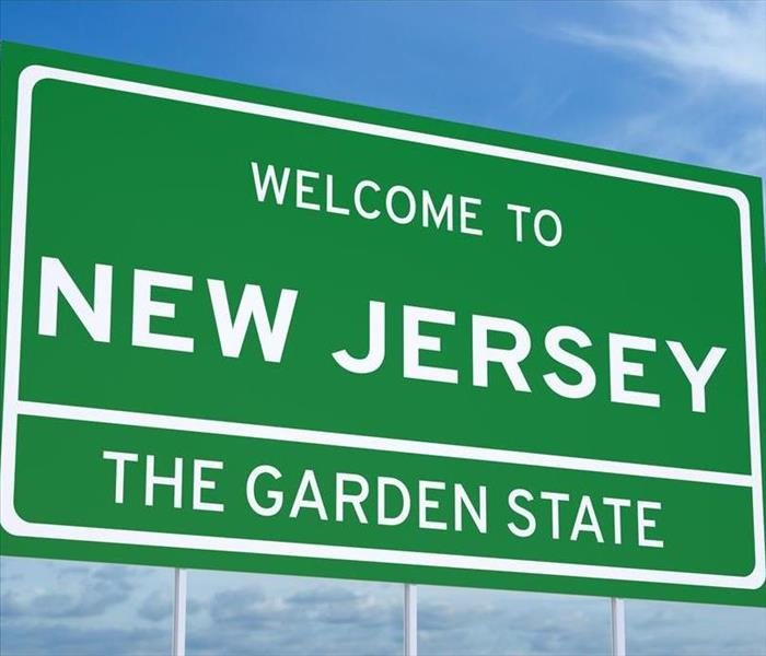 Green sign welcoming you to New Jersey.